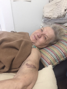 Pemberton's grandmother moments after her granddaughter had finished giving her her first tattoo. For the tattoo she chose her and her daughter's favorite plant. In this way, the tattoo symbolizes a connection between three generations of Pemberton's.