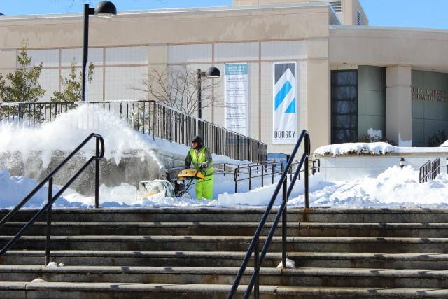 SUNY New Paltz employee plowing paths to the Student Union. Photo by Kate Bunster.