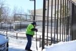 SUNY New Paltz employee shoveling outside the Student Union. Photo by Kate Bunster.