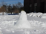 SUNY New Paltz students build a snowman outside their residence hall. Photo by Kate Bunster.