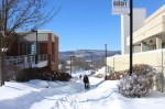 Students walk onto a winter wonderland campus. Photo by Kate Bunster.