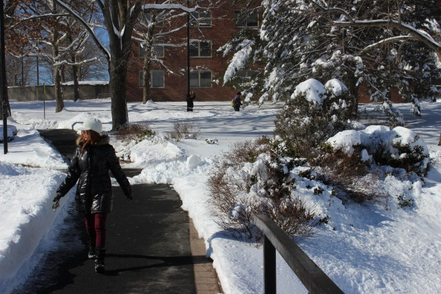 A student walking to Hasbrouck Dining Hall in the snow. Photo by Kate Bunster.