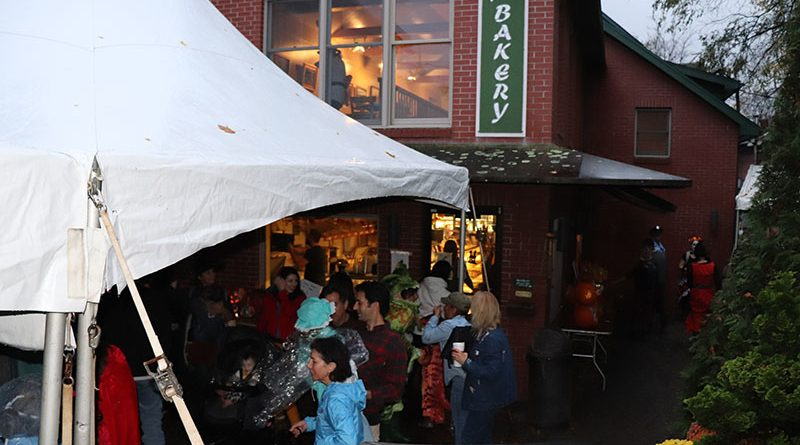 "People gather around The Bakery on 13 N. Front St. to view specialty carved pumpkins. The Bakery has hosted the ""Night of 100 Pumpkins"" Halloween night since 1990."