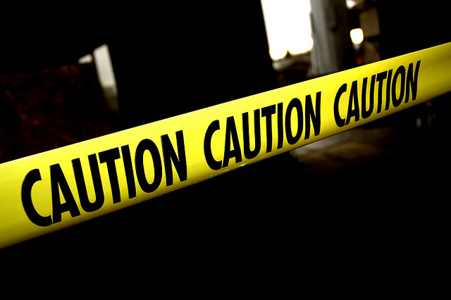 A photo of caution tape. Photo by Flickr user Picture Perfect Pose.