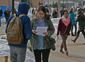 Students smoke outside academic buildings. Photo By Andrew Frey.