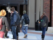 Students smoking near entrance. Photo By Andrew Frey. Photo By Andrew Frey.