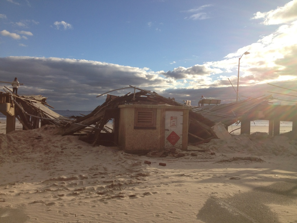 A maintenance booth in Long Beach, N.Y. sits under the rubble of the boardwalk. Photo by Kaitlyn Reddan