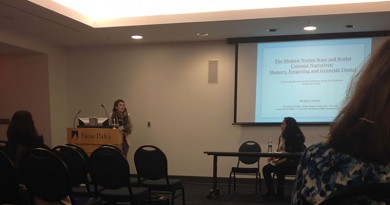 "Graduate student Kelsey Lizotte presents her research on multinational cases of genocide and cultural denial in ""The Politics of Memory, Forgetting and Genocidal Denial."" Photo by Katie Cusack."
