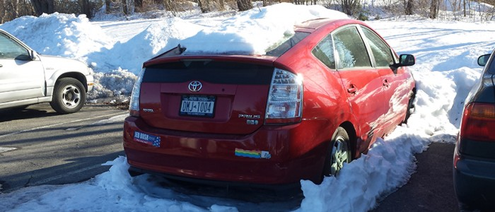 Snow covered cars still all over parking lots. By Jennifer Newman.