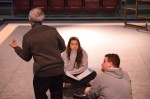 After actors work their lines while sitting, the director gives some helpful feedback. Photo by Jillian Nadiak.