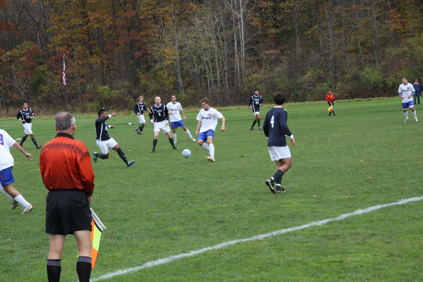 Fourth-year Captain Tommy Garafola passes the ball. Photo by Maria Schettini.