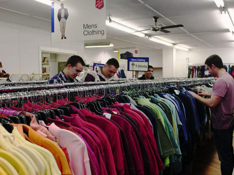 Though the men's clothing section is smaller than the women's, these thrifty college students still have a wide selection of formal and casual wear to choose from. Photo by Roberto LoBianco.