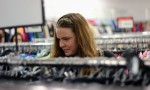 Erin Kellar, a fourth-year psychology student, is scouring through the T-shirt rack. Photo by Roberto LoBianco.